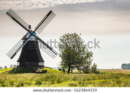 East Frisian landscape with windmill near the town of Leer, East Frisia, Lower Saxony, Germany  Stockfoto ©