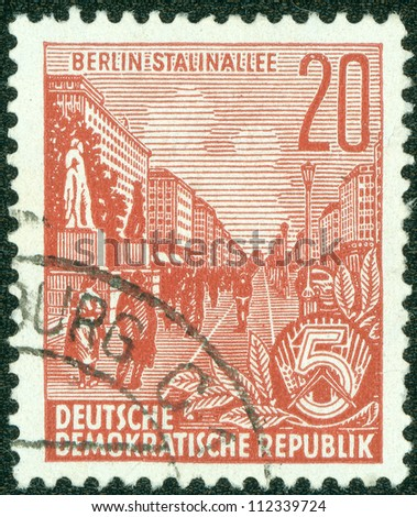 EAST GERMANY - 1953: A stamp printed in East Germany shows Stalin-Allee (also known as the Karl-Marx-Allee) in Berlin, series, circa 1953
