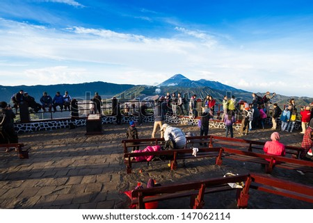 EAST JAVA,INDONESIA-MAY 06 : Tourists at viewpoint on Mount Penanjakan,The best views from Mount Bromo to the Sand Sea below and the surrounding volcanoes on May 06,2013 in East Java, Indonesia.