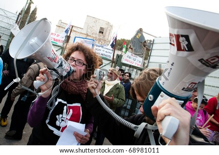 EAST JERUSALEM - JANUARY 14:  Israeli activists lead a demonstration against plans to construct a Jewish-only settlement on the site of the demolished Shepherd Hotel in East Jerusalem on Jan. 14, 2011