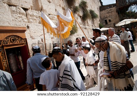 EAST JERUSALEM, OCCUPIED PALESTINIAN TERRITORIES - OCTOBER 31: Jewish worshipers gather for a Bar Mitzvah at the Western Wall, the holiest site in Judaism on Oct. 31, 2011.