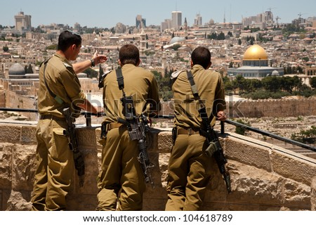 EAST JERUSALEM, PALESTINIAN TERRITORIES - JUNE 2: Israeli soldiers look at Jerusalem's Old City, June 2, 2012. Annexed by Israel, internationally it is still considered occupied Palestinian territory.