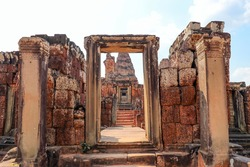 East Mebon entrance with towers and lions in Angkor complex, Siem Reap, Cambodia. The East Mebon is a 10th Century temple and it consists of three tiers. The construction in the style of Pre Rup.