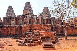 East Mebon entrance with towers and lions in Angkor complex, Siem Reap, Cambodia. The East Mebon is a 10th Century temple. The construction in the style of Pre Rup. Selective focus.