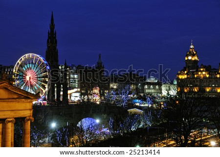East Princes Street Gardens, Edinburgh, Scotland, with Christmas and Hogmanay holiday attractions, at night.  The Royal Scottish Musem, Big Wheel, Scott Monument and Balmoral make a colourful scene.