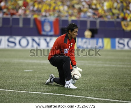 EAST RUTHERFORD NJ - AUGUST 12: Jose Cevallos #1 of Ecuador handles the ball against Jamaica during the International Friendly match at Giants Stadium on August 12 2009 in East Rutherford NJ