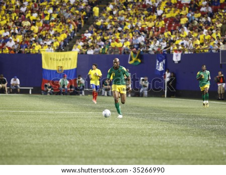 EAST RUTHERFORD NJ - AUGUST 12: Luton Shelton #11 of Jamaica handles the ball against Ecuador during the International Friendly match at Giants Stadium on August 12 2009 in East Rutherford NJ