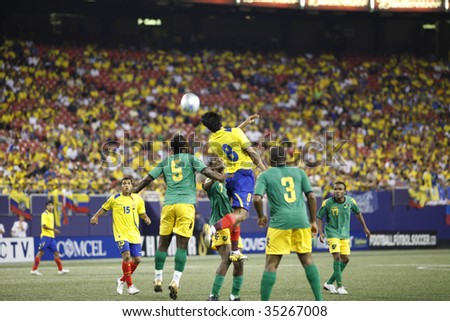 EAST RUTHERFORD NJ - AUGUST 12: midair collision for the ball during the International Friendly match Ecuador Jamaica at Giants Stadium on August 12 2009 in East Rutherford NJ