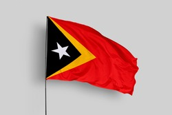 East Timor flag isolated on white background with clipping path. close up waving flag of East Timor. flag symbols of East Timor. East Timor flag frame with empty space for your text.