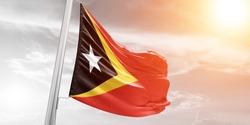 East Timor (Timor-Leste) flag waving on the wind