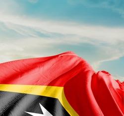 East Timor (Timor-Leste) waving flag in the sky.