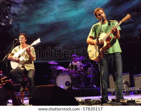 EAST TROY, WI - JUL. 24: Jack Johnson and G. Love perform during the 2010 To The Sea tour in East Troy, Wisconsin at Alpine Valley Music Theater on July 24, 2010 in East Troy, MI. - stock photo