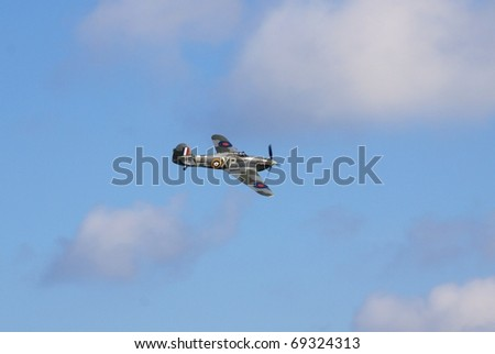 EASTBOURNE, ENGLAND - AUGUST 14: A second world war Hawker Hurricane fighter performs at the Airbourne airshow on August 14, 2010 at Eastbourne, East Sussex. This example was built in 1940 in Canada. - stock photo
