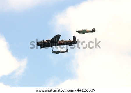 EASTBOURNE, ENGLAND-AUGUST 16: The Battle of Britain Memorial Flight consisting of a Lancaster bomber flanked by a Hurricane and Spitfire, giving a display on August 16, 2009 in Eastbourne, Sussex. - stock photo