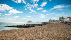 Eastbourne Seafront and Pier, East Sussex, England. A summer view of the seafront of the English south coast seaside town with its landmark pier.