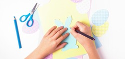 Easter activities. Dot to dot painting bunny game. Line art easter rabbit game for children. Dot to dot drawing activity page. Selective focus. Top view.