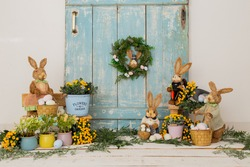 Easter backdrop or background for photo mini session in blue color. Contains straw rabbits and eggs basket.