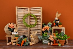 Easter backdrop or background for photo mini session in brown color. Contains straw rabbits.