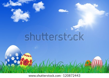 Easter background with decorated Easter eggs in a sunny field