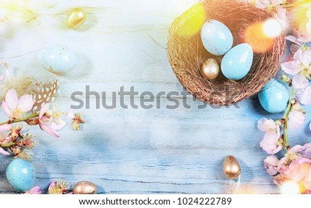 Easter background with Easter eggs and spring flowers #1024222789