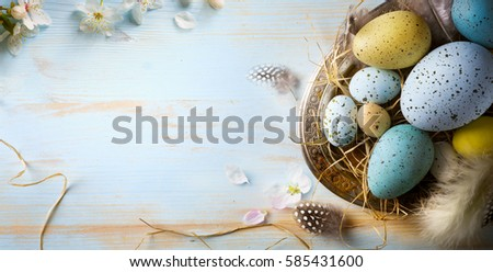 Easter background with Easter eggs and spring flowers. Top view with copy space #585431600