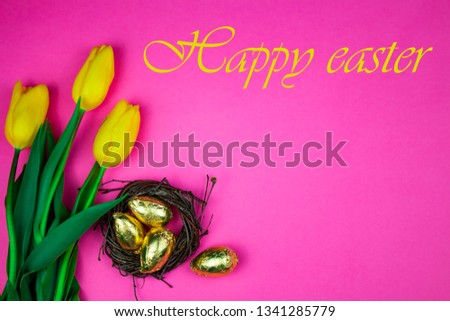 Easter background with Easter eggs and spring flowers. Top view with copy space. Copy space