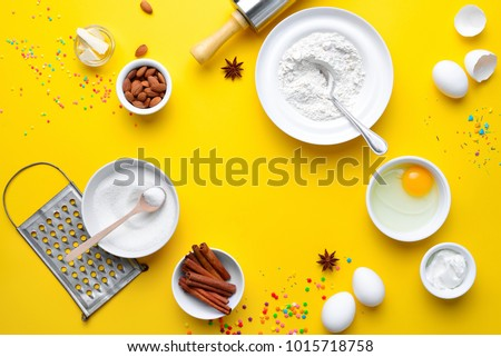 Easter bakery concept, various products for home baking, such as sugar, butter, yogurt and eggs and flour, view from above arrangement, blank space for a text #1015718758