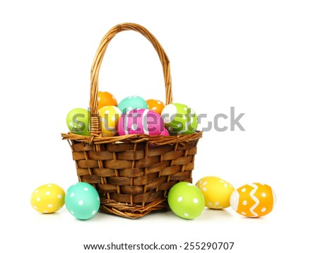 Stock Photo Easter basket filled with colorful eggs on a white background