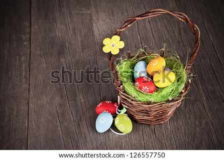 Easter basket on wooden table