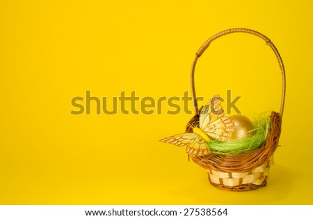 Easter basket on yellow background. Lot`s of copyspace