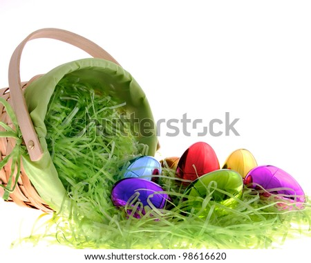 Easter basket with iridescent Easter Eggs. - stock photo