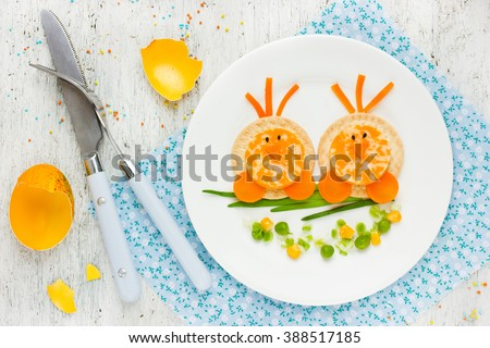 Easter breakfast for kids food art idea cute Easter chicks on branch morning snack on white background top view