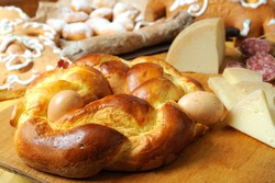 Easter breakfast typical of the Abruzzo region in Italy with Easter pizza eggs salami sweet cheese called pupa and bocconotti typical Abruzzo dessert