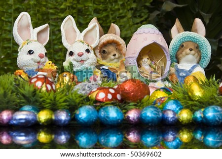 Easter bunnies and chocolate Easter eggs as decoration