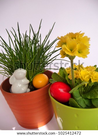 Easter bunny and Easter eggs An Easter bunny and Easter eggs in a pot with chives  #1025412472
