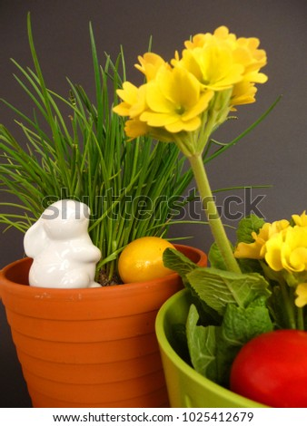 Easter bunny and Easter eggs An Easter bunny and Easter eggs in a pot with chives  #1025412679