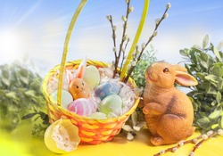 Easter Bunny and Eggs with Cloudy and Sunny Sky Background