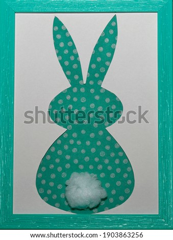 Easter bunny craft paper applique in aquamarine color photo frame on a white background. Top view. Happy Easter Day concept. Minimalizm. Easter card.                            Stok fotoğraf ©