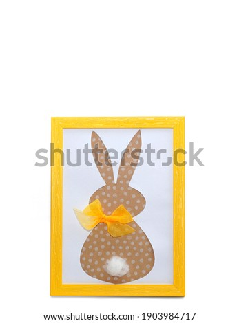 Easter bunny craft paper applique in yellow photo frame isolated on a white background. Happy Easter Day, Mother Day concept. Minimalizm. Easter card. Copyspace.                                       Stok fotoğraf ©