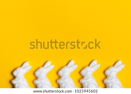 Easter bunny rabbits on a bright yellow background #1025945602