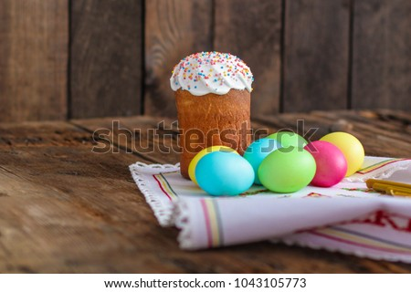 Easter cake and Easter eggs (traditional decoration and attributes). Happy easter! - Shutterstock ID 1043105773