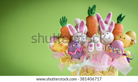 Easter cake pops concept on green background with copy space