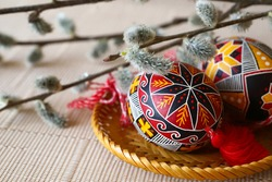 Easter card. Easter eggs, with colorful ornaments, decorated with a willow branch. Symbols of Palm Sunday and Easter. The concept of Orthodoxy.