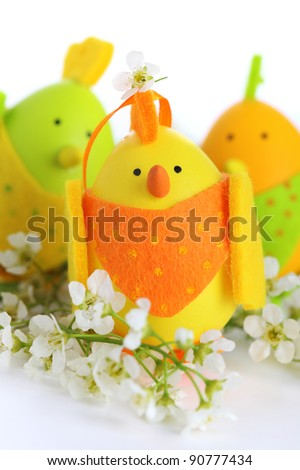 Easter chick decoration with flowers on a white background