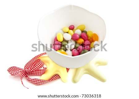 Easter chicken bucket filled with colorful eggs isolated over white
