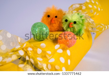 Easter Chicks on an Easter Cracker or otherwise known as a Bon Bon. A traditional cracker consists of a cardboard tube wrapped in a brightly decorated twist of paper with a gift in the central chamber