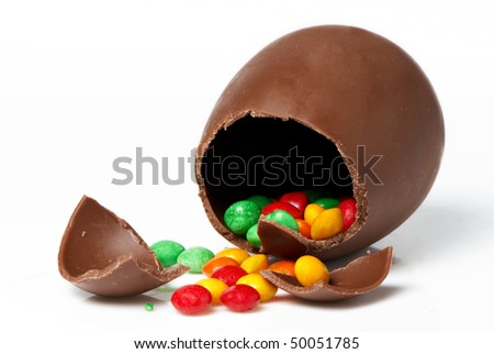 easter chocolate egg and sweets  on a light background