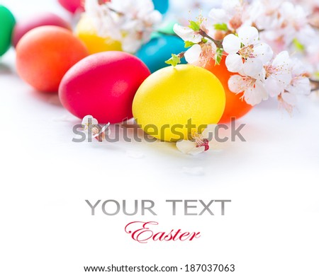 Easter Colorful Easter eggs with spring blossom flowers isolated over white background Colored Egg Holiday border art design