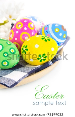 easter coloured eggs in plate isolated on white background