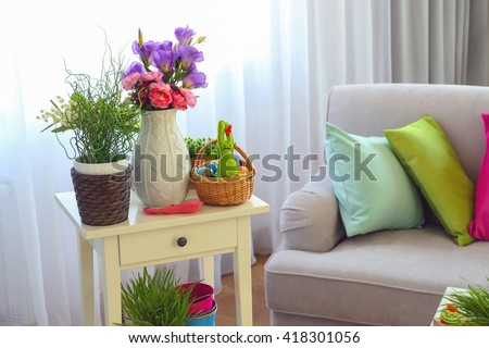 Easter composition with eggs and plants in living room #418301056